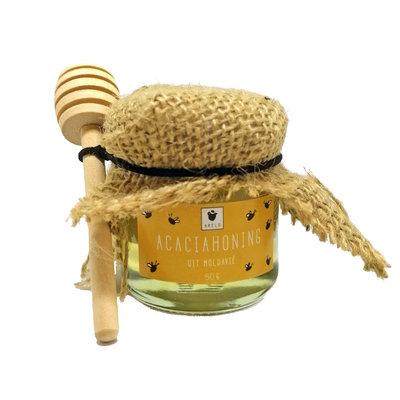 Honingpotje met lepeltje